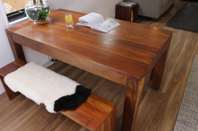 Wooden dining table with two timber benches